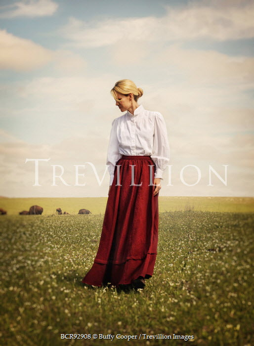 Buffy Cooper HISTORIC YOUNG WOMAN STANDING IN FIELD Women