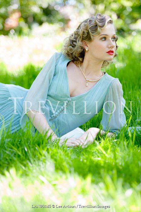 Lee Avison 1930s woman relaxing in the grass in summer Women