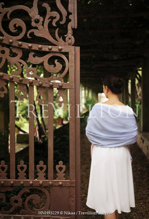 Nikaa YOUNG WOMAN IN SHAWL BY IRON GATE Women
