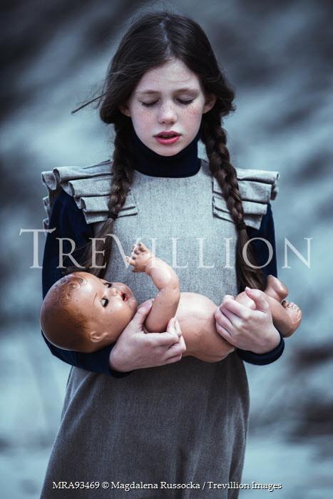 Magdalena Russocka young girl holding china doll Women