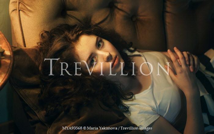 Maria Yakimova SERIOUS GIRL LYING ON SOFA Women