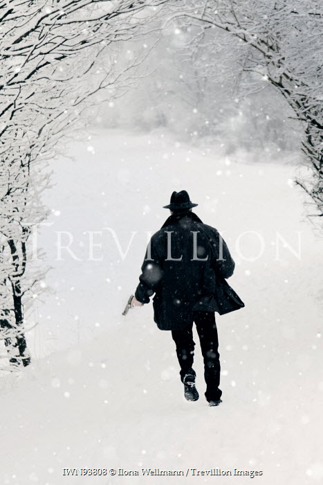 Ilona Wellmann MAN RUNNING WITH GUN IN SNOWY COUNTRYSIDE Men