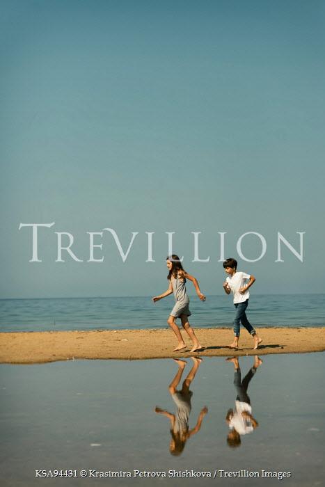 Krasimira Petrova Shishkova BOY AND GIRL RUNNING ON BEACH Children