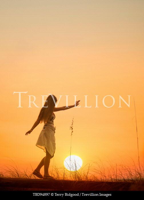 Terry Bidgood GIRL BALANCING ON BRIDGE AT SUNSET Women