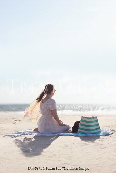 Susan Fox WOMAN SITTING BY THE BEACH Women