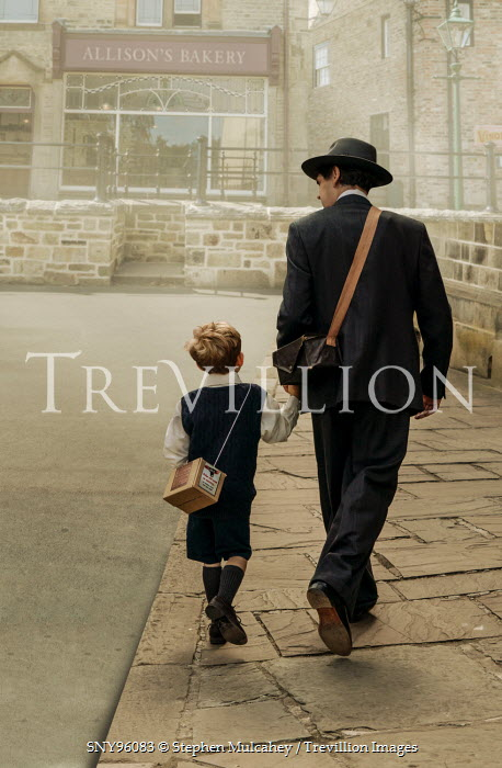 Stephen Mulcahey A  father and son from the forties walking down the street Children