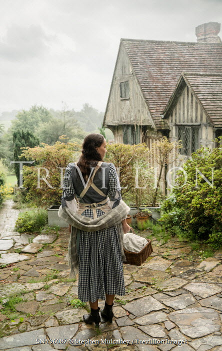 Stephen Mulcahey A maid walking towards a manor house Women