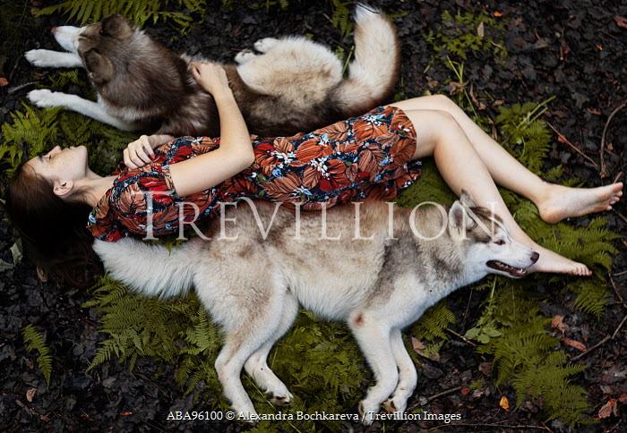 Alexandra Bochkareva WOMAN LYING WITH DOGS OUTDOORS Women