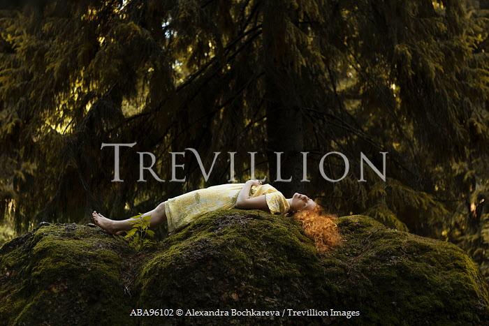 Alexandra Bochkareva WOMAN LYING ON MOSSY ROCK BY TREE Women