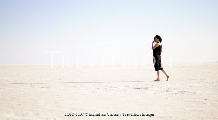 Esmahan Ozkan WOMAN WALKING IN SAND Women