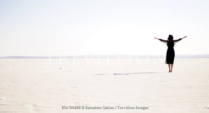 Esmahan Ozkan WOMAN ON SAND ARMS OUTSTRETCHED Women