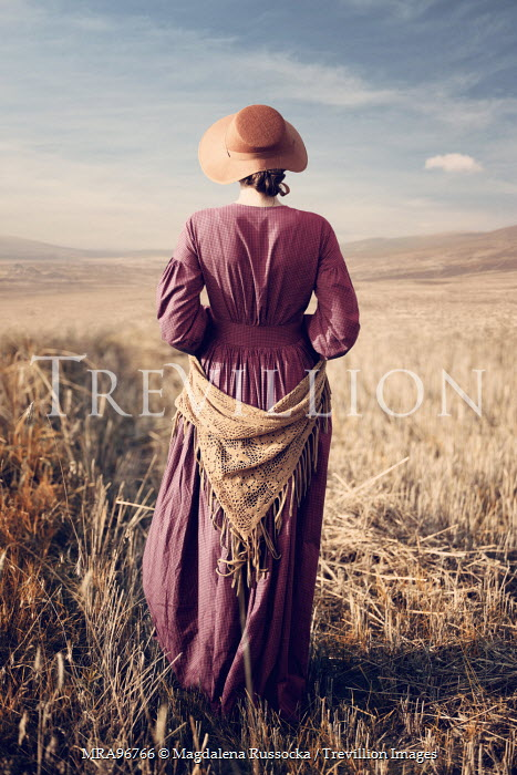 Magdalena Russocka historical woman standing in golden landscape Women