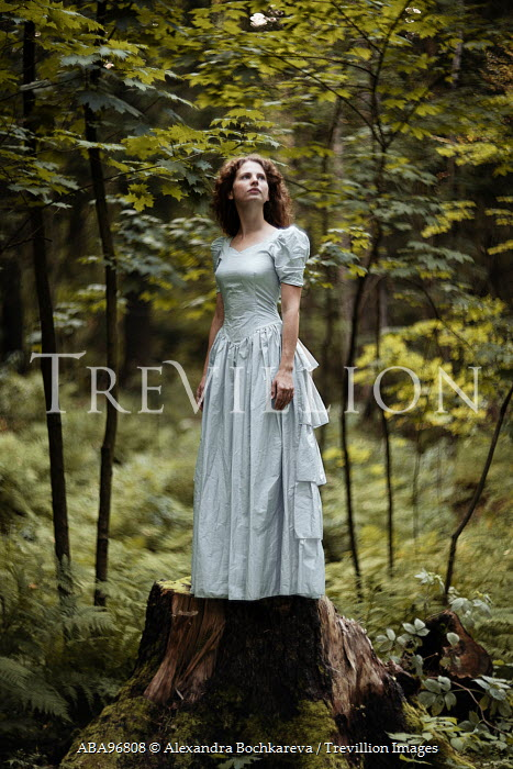 Alexandra Bochkareva WOMAN ON TREE STUMP IN FOREST Women