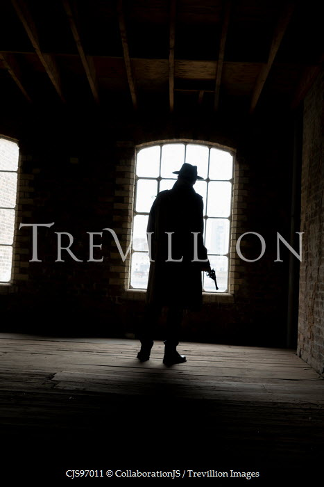 CollaborationJS silhouette of man in old building Men