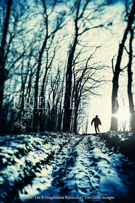 Magdalena Russocka man running through forest in winter Men