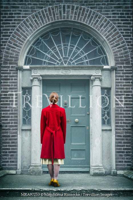 Magdalena Russocka woman in red coat standing at door Women