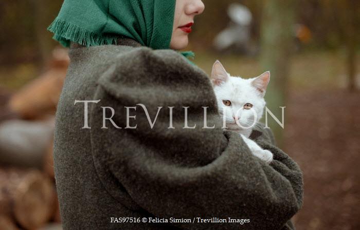 Felicia Simion RETRO WOMAN HOLDING CAT OUTDOORS Women