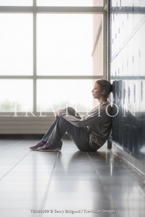 Terry Bidgood YOUNG WOMAN LEANING AGAINST LOCKERS Women