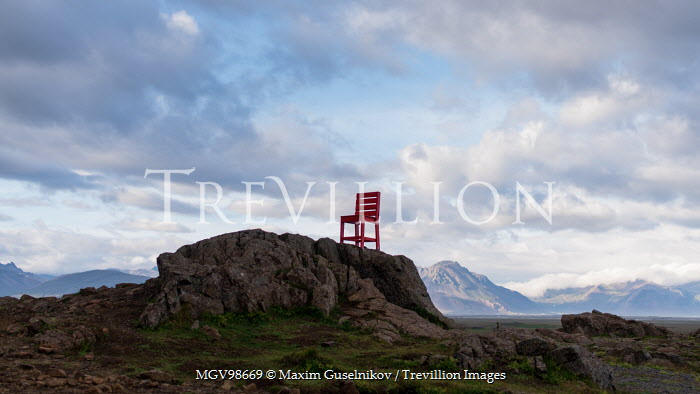 Maxim Guselnikov RED CHAIR ON ROCK IN LANDSCAPE Miscellaneous Objects