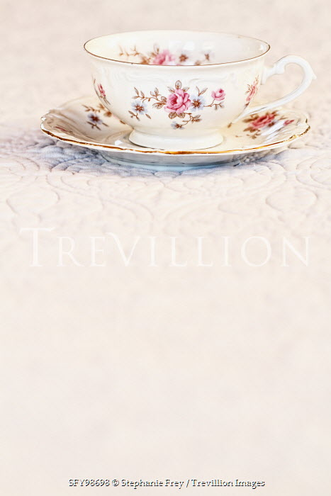 Stephanie Frey floral teacup and saucer on tablecloth Miscellaneous Objects