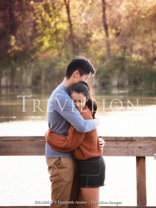 Elisabeth Ansley ASIAN COUPLE EMBRACING BY LAKE Couples