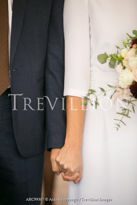 Aida Redzepagic CLOSE UP OF COUPLE HOLDING HANDS AT WEDDING Couples