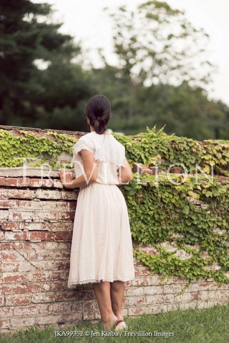 Jen Kiaba WOMAN PEERING OVER GARDEN WALL Women