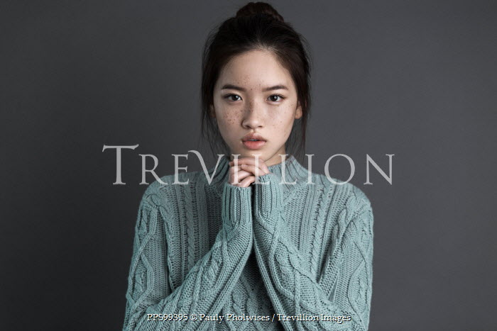 Pauly Pholwises THOUGHTFUL ASIAN GIRL IN BLUE SWEATER Women