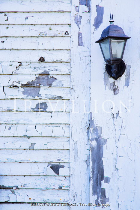 Irene Suchocki LAMP ON WHITE WEATHERED BUILDING Building Detail