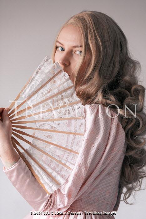 Rekha Garton VINTAGE WOMAN WITH CURLED HAIR HOLDING FAN Women