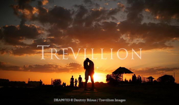 Dmitriy Bilous SILHOUETTE OF COUPLE KISSING AT SUNSET Couples
