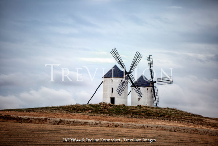 Evelina Kremsdorf TWO WINDMILLS ON HILL IN FIELD Miscellaneous Buildings