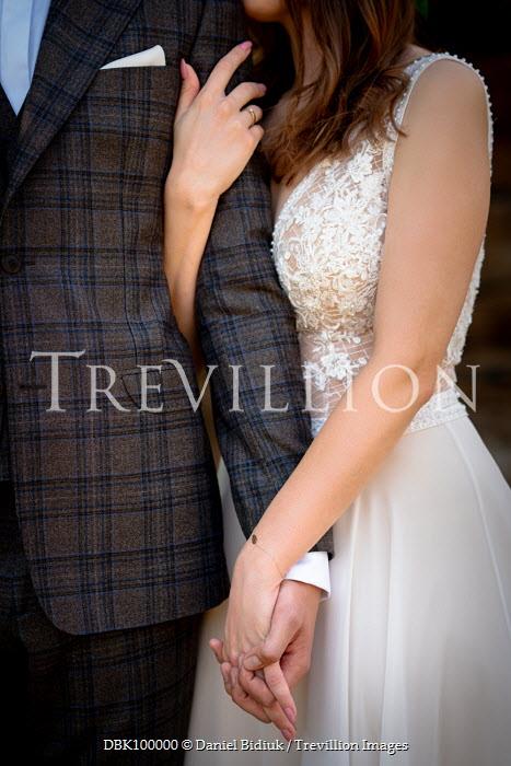 Daniel Bidiuk WOMAN IN WEDDING DRESS HUGGING MAN Couples