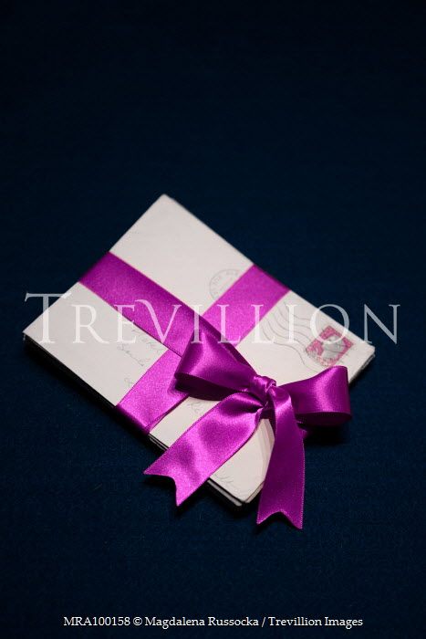 Magdalena Russocka letters tied with purple ribbon