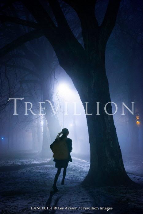 Lee Avison girl running through trees at night in fog