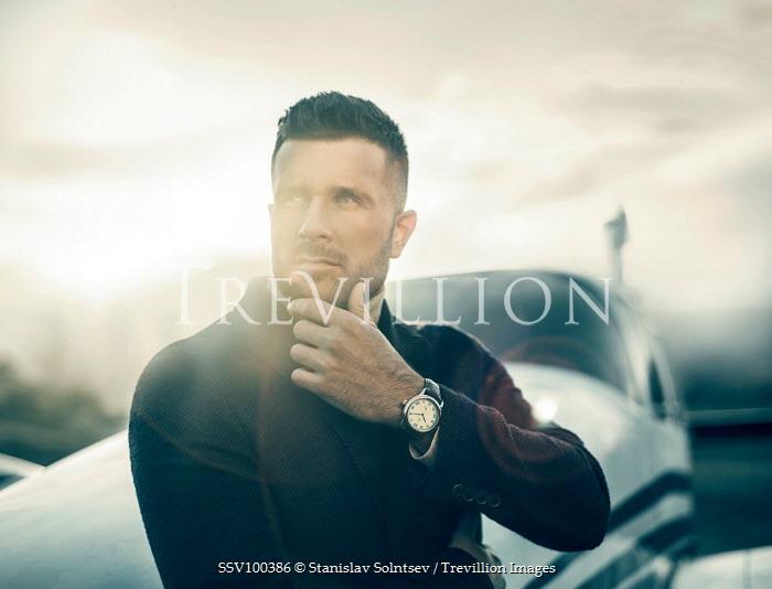 Stanislav Solntsev MAN STANDING NEXT TO AEROPLANE Men