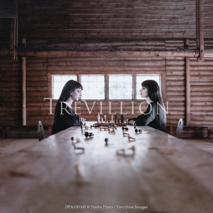 Dasha Pears TWO BRUNETTE GIRLS PLAYING CHESS INDOORS Women
