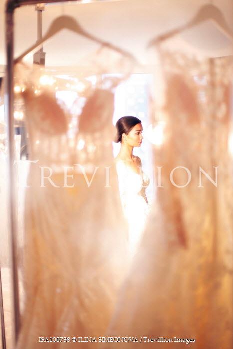 ILINA SIMEONOVA WOMAN STANDING NEAR WEDDING DRESSES Women