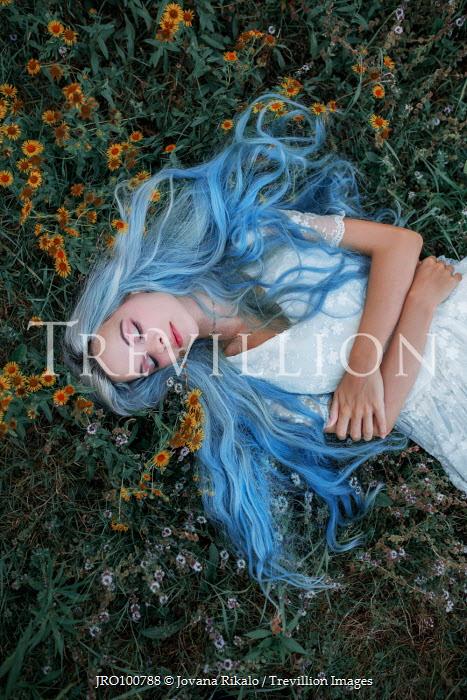 Jovana Rikalo WOMAN WITH BLUE HAIR LYING ON GRASS Women