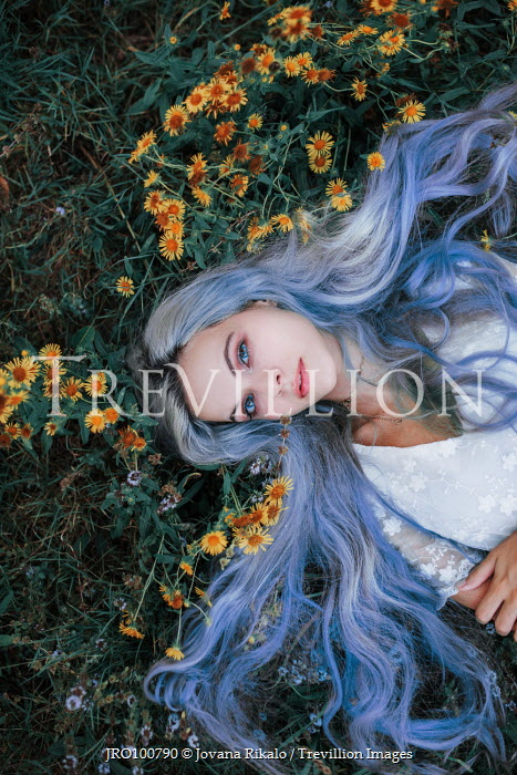 Jovana Rikalo WOMAN WITH BLUE HAIR LYING ON GRASS Women