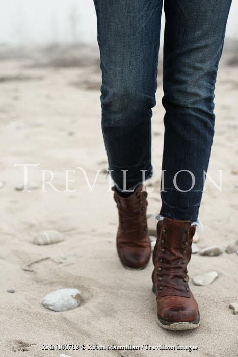 Robin Macmillan CLOSE UP OF FEMALE LEGS WALKING ON BEACH Women