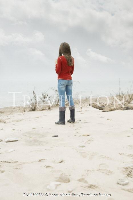 Robin Macmillan GIRL IN BOOTS STANDING ON BEACH Women