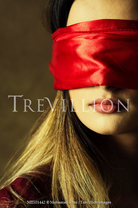 Mohamad Itani CLOSE UP OF WOMAN IN RED BLINDFOLD Women
