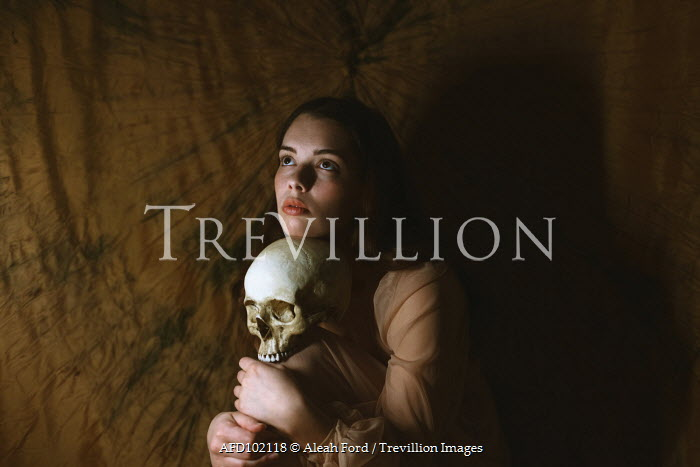 Aleah Ford WOMAN IN SHADOW SITTING WITH SKULL Women