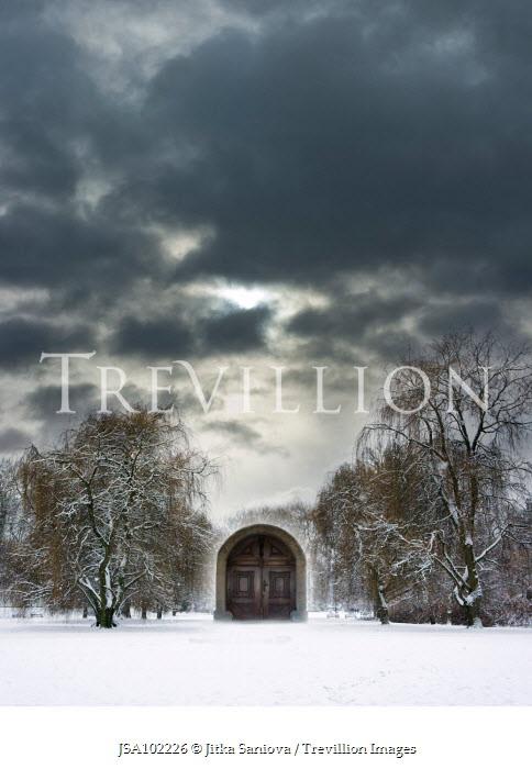 Jitka Saniova WOODEN DOORWAY IN FIELD OF SNOW Miscellaneous Buildings