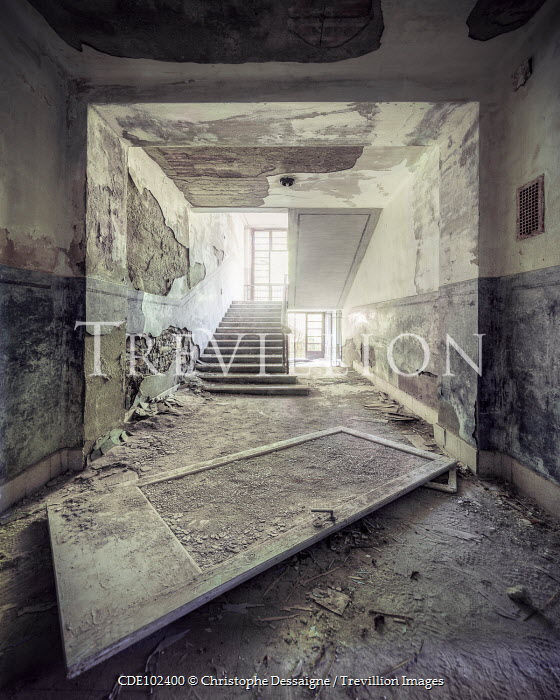 Christophe Dessaigne INTERIOR OF DERELICT BUILDING WITH STAIRCASE Interiors/Rooms