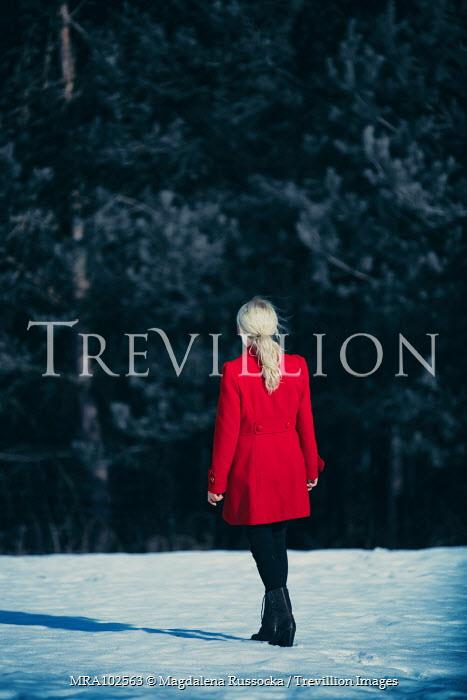 Magdalena Russocka woman wearing red coat standing in snowy field