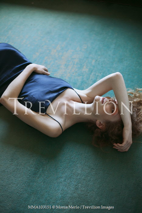 Monia Merlo WOMAN IN BLUE DRESS LYING ON FLOOR Women