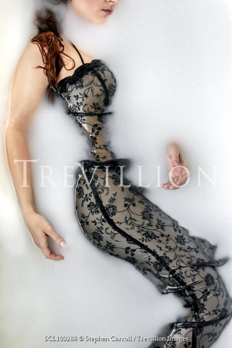 Stephen Carroll WOMAN IN DRESS LYING IN BATH Women
