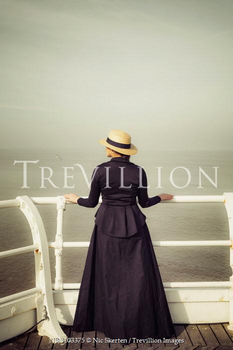 Nic Skerten HISTORICAL WOMAN BY RAILING WATCHING SEA Women